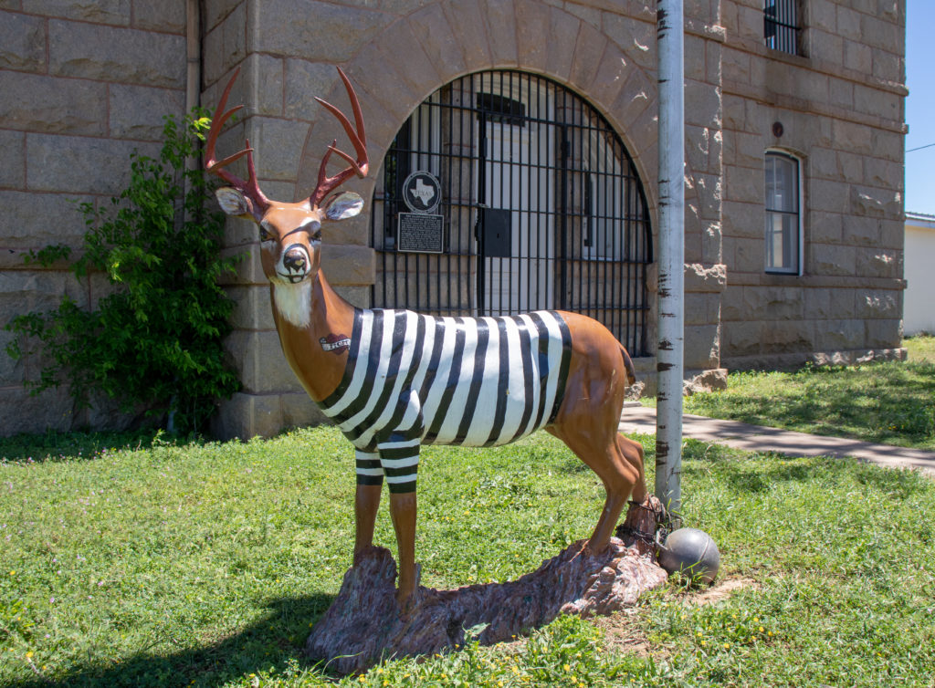 picture of red top jail deer statue