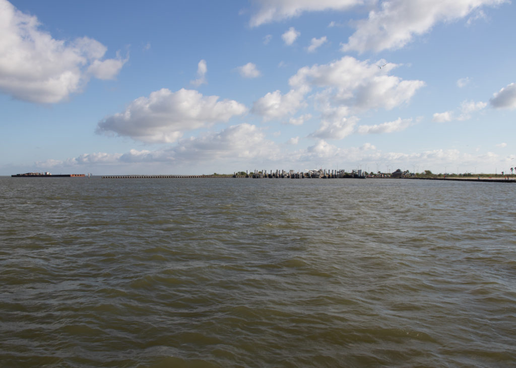 picture of galveston ferry approaching port bolivar